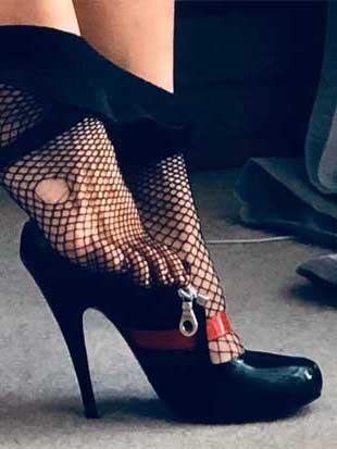 feet in fishnet pantyhose and high heels